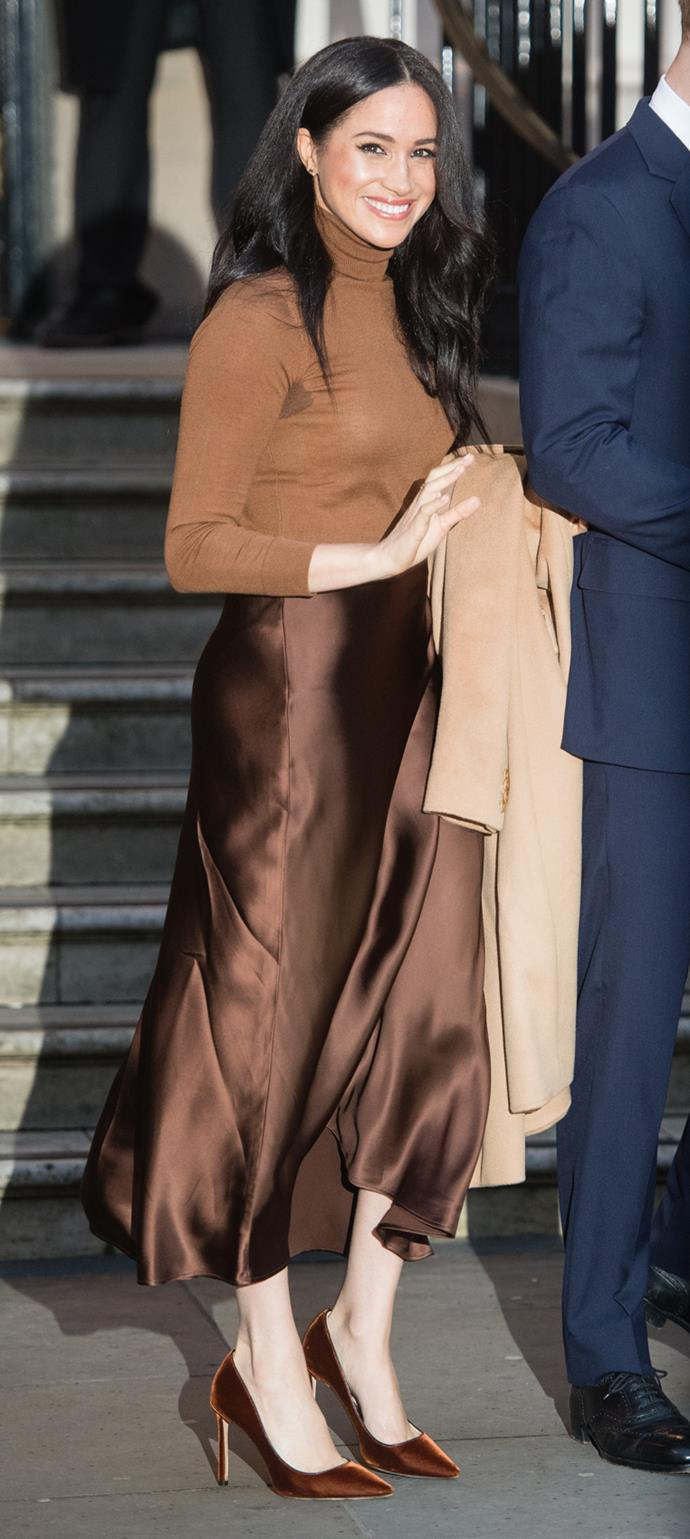 Meghan nailed the art of transeasonal dressing, and has single-handedly sparked a desperate sales surge in silk skirts and turtle neck tops. Obsessed.