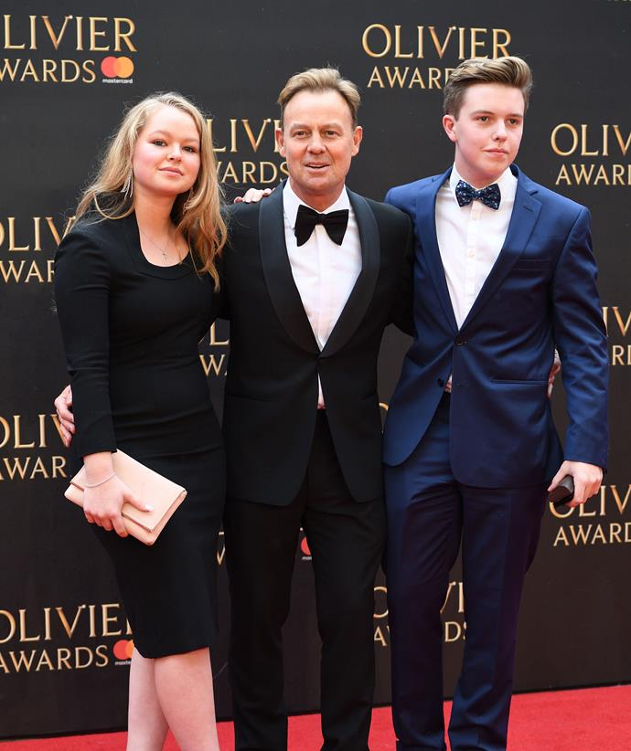 Jason (centre) pictured with his two children on the red carpet.