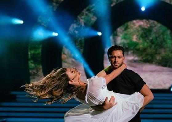 Chloe dances with professional dancer, Gustavo Viglio, on Dancing With the Stars.