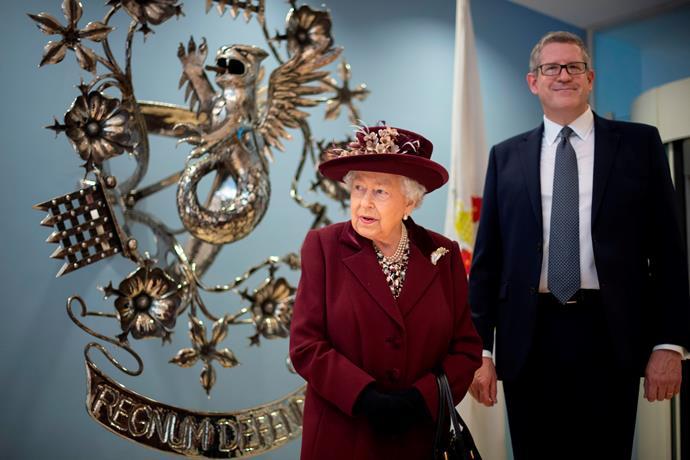 Pretty in plum: Queen Elizabeth paid a surprise visit to MI5 headquarters in London.
