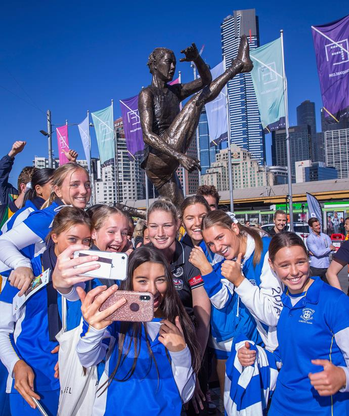 Schoolgirls flank Tayla (centre) at the unveiling of her statue in September 2019.