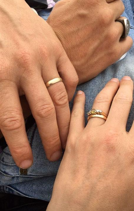 The couple shared a photo of their wedding bands.