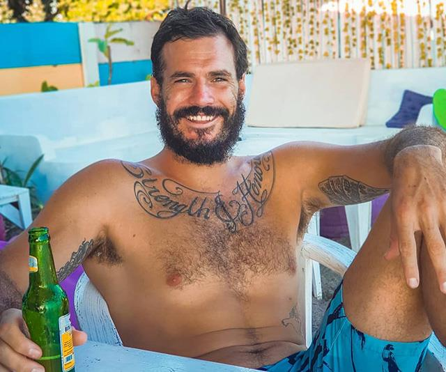"""Locky chilling out with a beer. FYI, his tattoo says """"Strenght and Honour""""."""