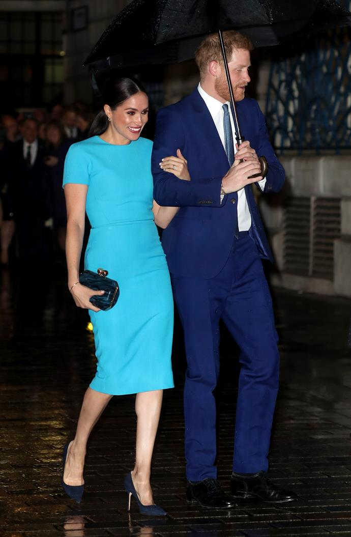 The Duke and Duchess didn't let a little rain hold them back from positively glowing.