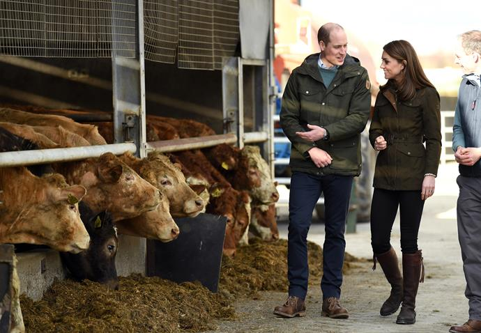 Visiting a farm that afternoon, Kate and Wills were all smiles in their very farm appropriate gear.