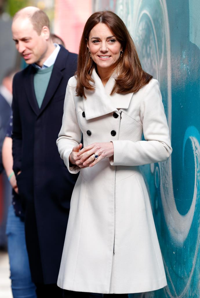 On day two of Kate and Wills' royal tour, the Duchess rugged up with another old favourite - her dreamy cream Reiss coat.