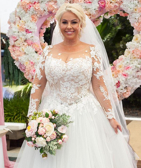 "***Lucy Robinson, marrying Mark Gottlieb*** <br><br>  Scott (Jason Donovan) and Charlene's (Kylie Minogue) wedding may have been one of Neighbours most iconic, but when it comes to the white gown Lucy Robinson (Melissa Bell) takes the cake. <br><br> ""I think it's one of the biggest dresses in the history of Neighbours – even bigger than Kylie's [Charlene],"" Melissa tells *TV WEEK*. <br><br> ""I got to pick any dress I wanted, it's very fairytale, with a huge train and veil."" <br><br> With lace detailing across the bodice, full tulle skirt and veil to match, Melissa is a vision in white."