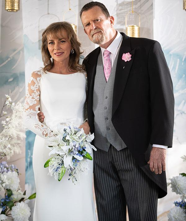 ***Jane Harris, marrying Des Clarke***<br><br>  Plain Jane Superbrain (Annie Jones) is anything but when she finally makes it down the aisle after a tumultuous and troublesome love life! <br><br> The picture of elegance and grace, Jane proves you can pull off a wedding dress at any age in a simple column gown with lace detail sleeve.