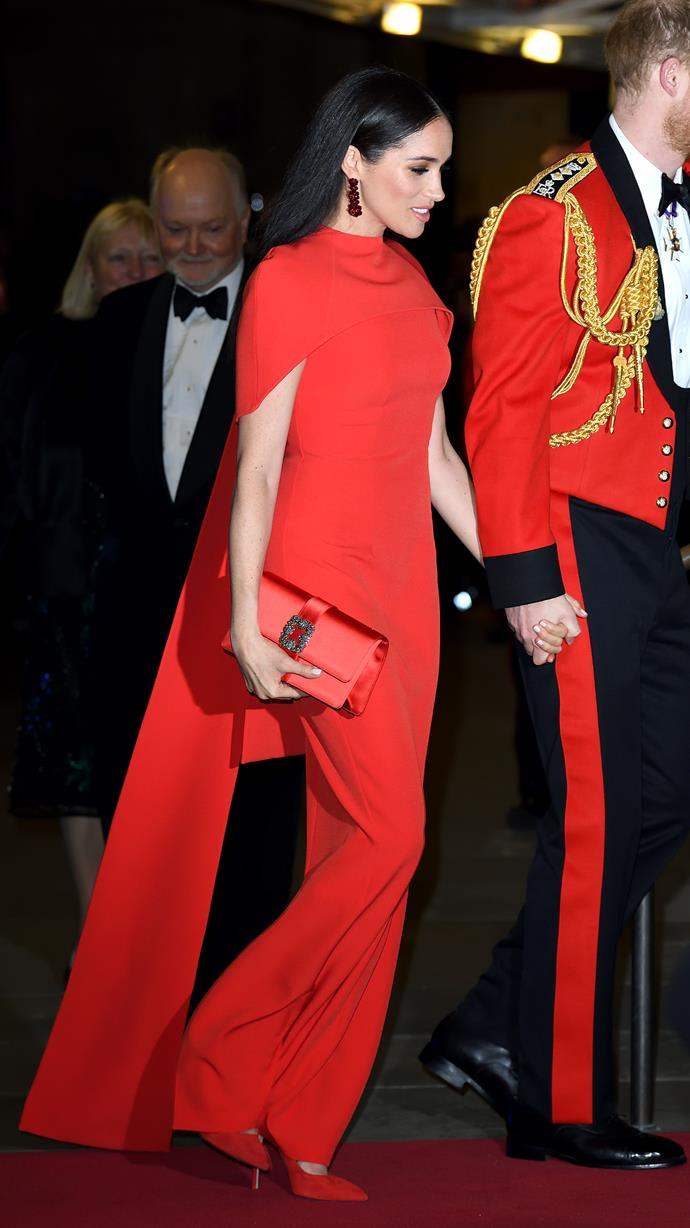 "Meghan made a fiery red statement as she attended the [Mountbatten Music Festival](https://www.nowtolove.com.au/royals/british-royal-family/meghan-markle-red-dress-62956|target=""_blank"") on March 7. The Duchess opted for this glorious Safiyaa dress. The style is clearly a favourite for the Duchess - she previously wore a blue version of the frock back in 2018 while touring Fiji."