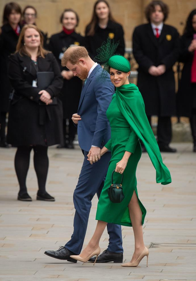 Not all heroes wear capes, but Meghan does! She was glowing in green as she and Harry made their grand entrance.