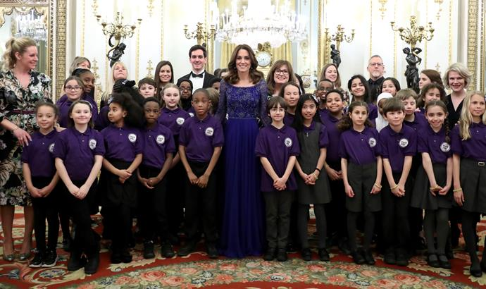 Kate posed with a number of children involved with the charity during the gala dinner at Buckingham Palace.