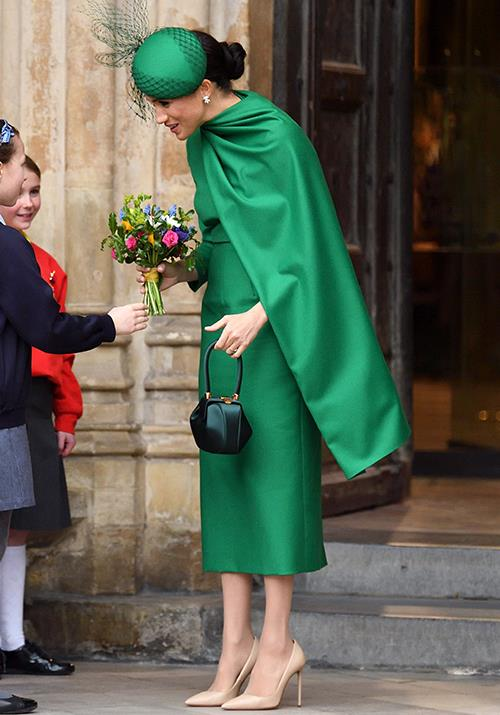 "The Duchess added some glamorous accessories to her heavenly look, including a [classy green fascinator](https://www.nowtolove.com.au/royals/british-royal-family/kate-middleton-meghan-markle-commonwealth-day-2020-62977|target=""_blank"") designed by William Chambers, a Gabriela Hearst handbag and her favourite Aquazzura nude pumps."