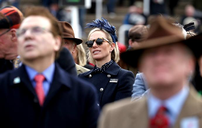 Zara looked chic in a pair of Illestiva tortoiseshell sunglasses as she watched the day's events unfold.