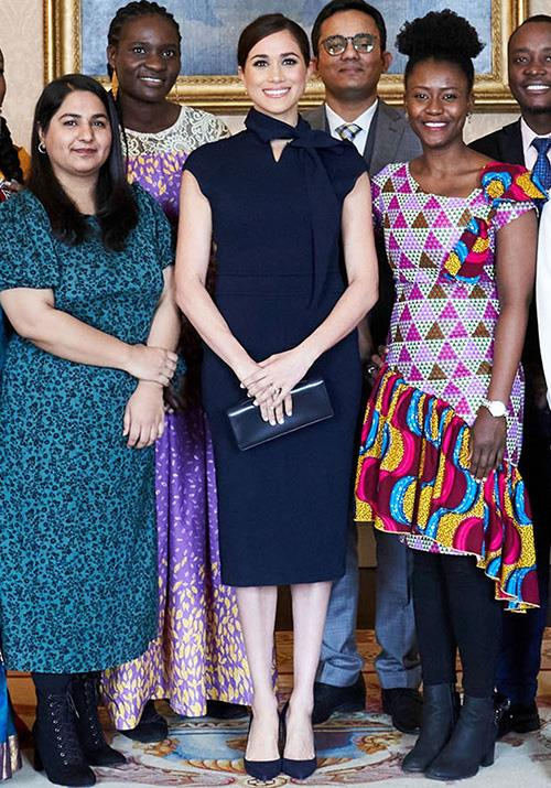 Meghan opted for a chic navy dress by Scanlan Theodore for the occasion.