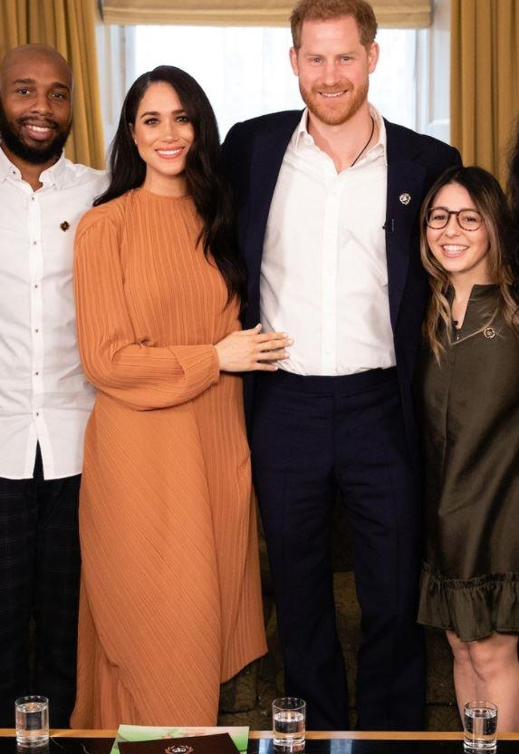 Meghan and Harry attended another meeting at Buckingham Palace a few days before in conjunction with the Queen's Commonwealth Trust. Wearing a gorgeous, autumnal toffee coloured pleat dress by Preen, the Duchess proved she was on a fashion roll.