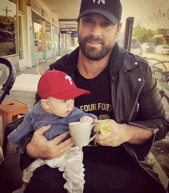"Jake shared this pic of himself and Wolf at a Melbourne cafe, remarking on his son's first *proper* coffee experience: ""1ST MElb coffee for the 🐺 man. Bellissimo ☕️ 🇮🇹👶🏻,"" he penned."
