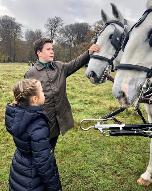 Ahead of the annual Hubertus Hunt, Prince Christian and Princess Josephine took a moment to greet the horses.