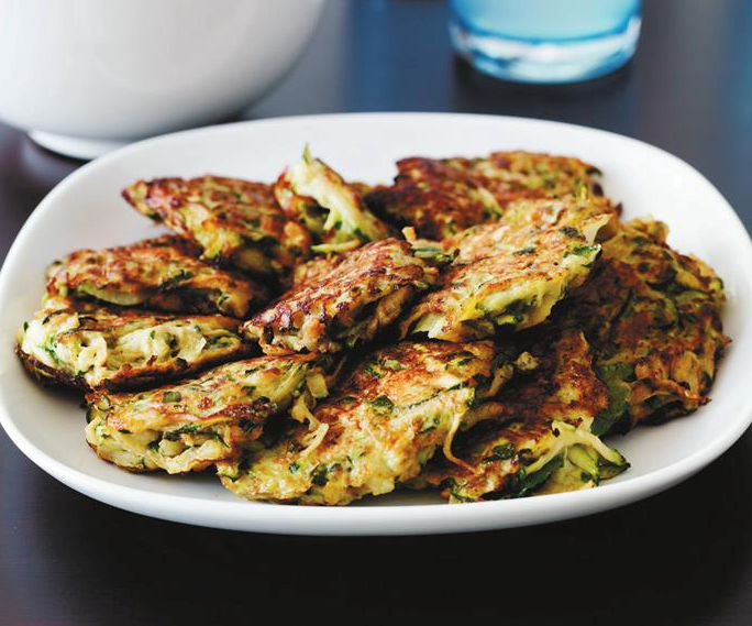 """These **[zucchini fritters](https://www.womensweeklyfood.com.au/recipes/zucchini-fritters-with-tzatziki-9069