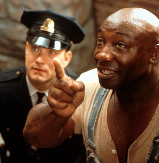 ***The Green Mile*** <br><br> A quick warning, this movie is *heavy*, but boy is it brilliant. Set on America's death row, Tom's character Paul Edgecomb meets an inmate who is accused of murdering two girls. But the story takes a turn when it's revealed the man has a special gift.