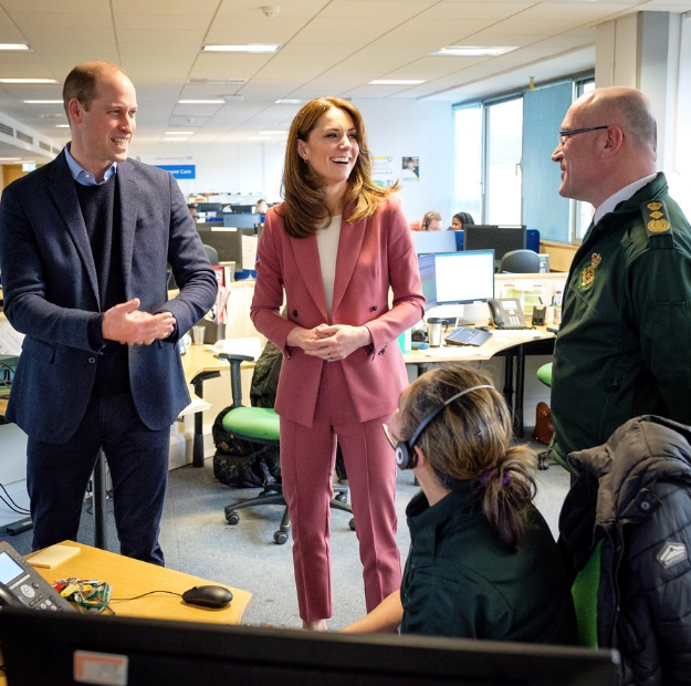 Prince William and Duchess Catherine chat with healthcare workers in London.