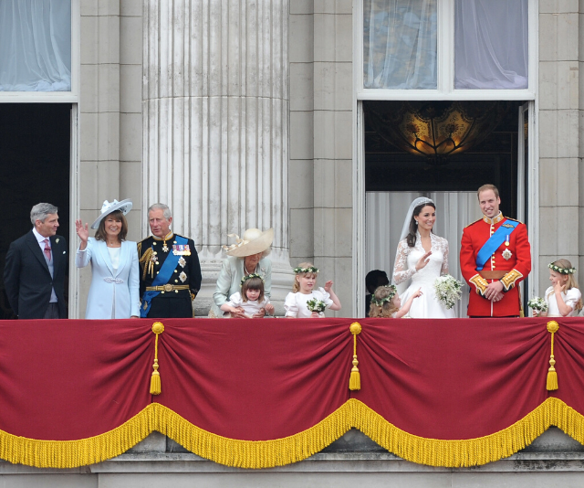 Carole and Kate waved like pros on the Buckingham Palace balcony after the wedding service at Westminster Abbey.