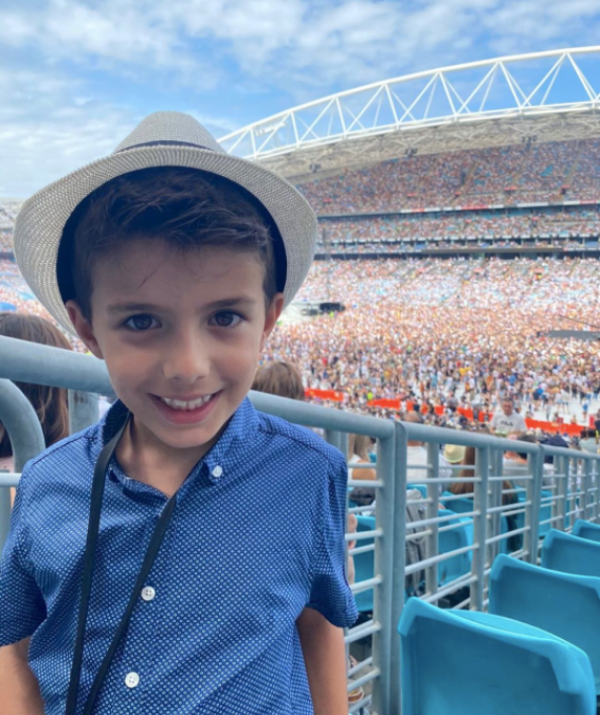 Johnas may be young but he has great taste in music, pictured here at the recent Queen bushfire benefit concert in Sydney.