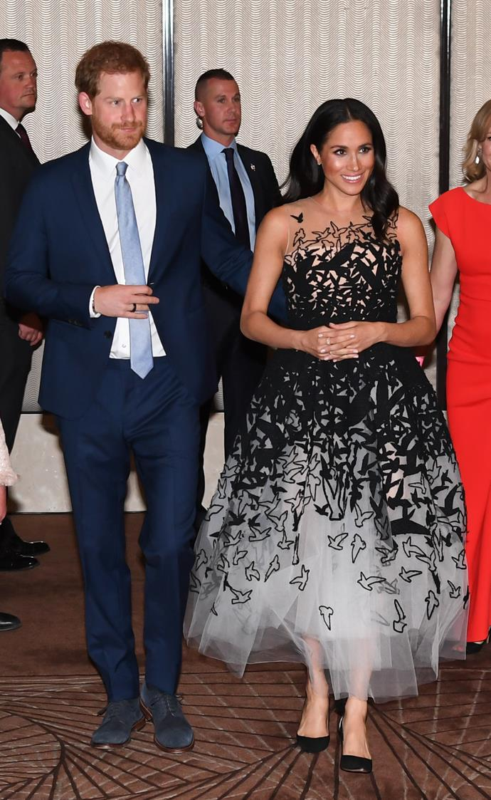 """The world, AKA fashion enthusiasts, were impressed when Meghan and Harry stepped out to attend the Australian Geographic Society Awards in Sydney a few days later. The pregnant Duchess' [Dior creation](https://www.nowtolove.com.au/royals/british-royal-family/meghan-markle-maternity-fashion-51842