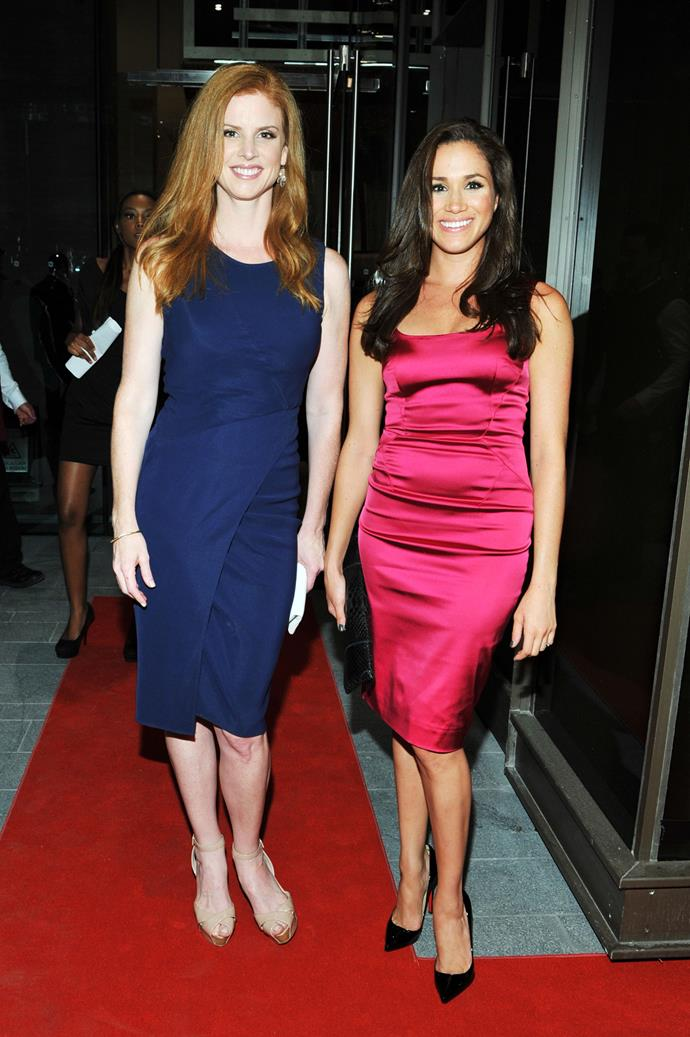 Alongside her former *Suits* co-star Sarah Rafferty, the then-Meghan Markle shone in hot pink.