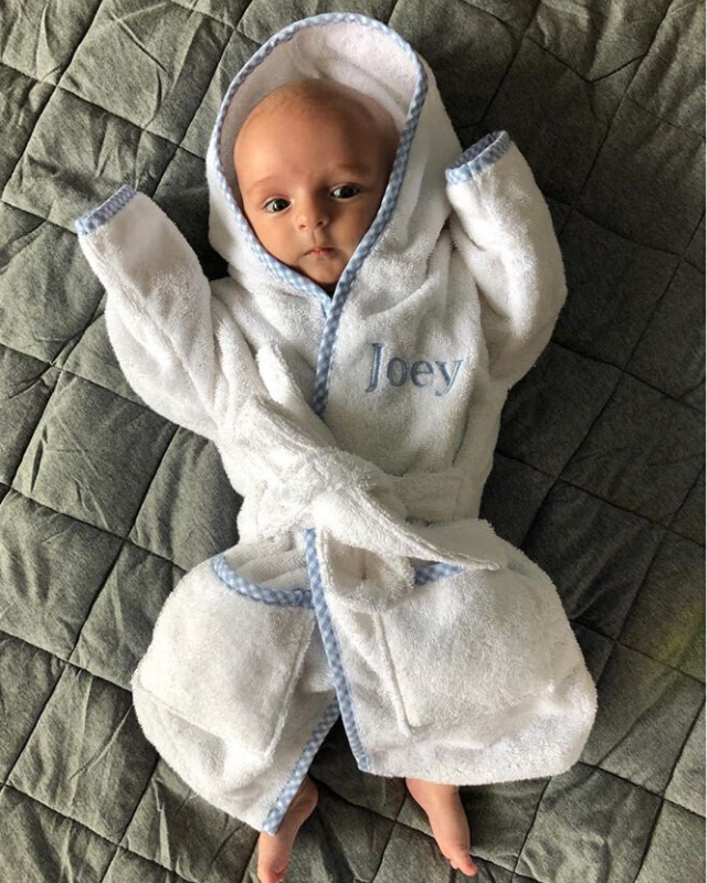 "With people's newsfeeds filled with doom and gloom during the coronavirus pandemic, Jayne posted this unbelievably cute photo of Joey all wrapped up in a monogrammed robe, to try and brighten the mood.  <br><br> ""We all feel a bit sad at the moment, so here's a cute baby to make you smile 😊,"" she wrote, adding that the cute robe was a ""Gorgeous gift from my Italian friend Anna.. giving Joey the Royal touch in a @my1styears robe. Totally squishable and isolation-approved 💙"""