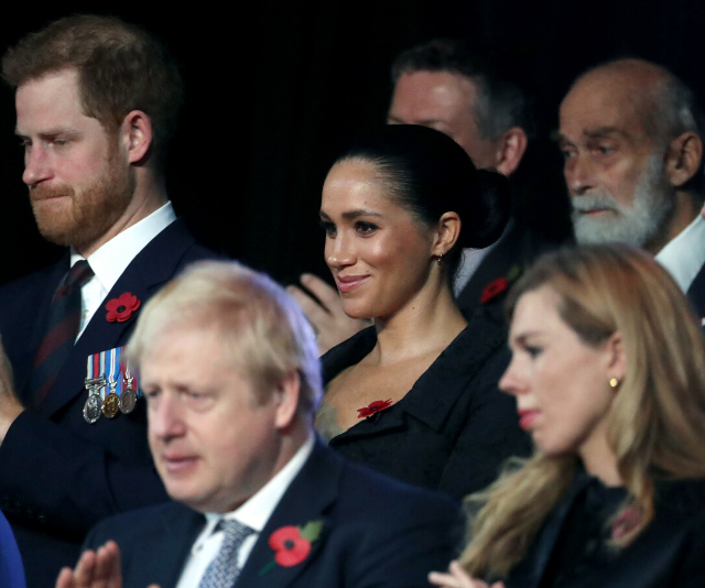 Sitting alongside Prince Harry and Duchess Meghan at a formal event last year.