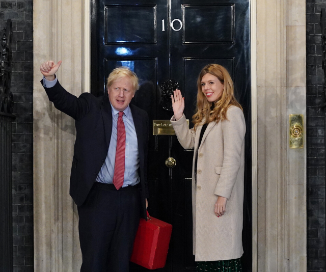 Pictured outside the official PM's residence, 10 Downing Street.