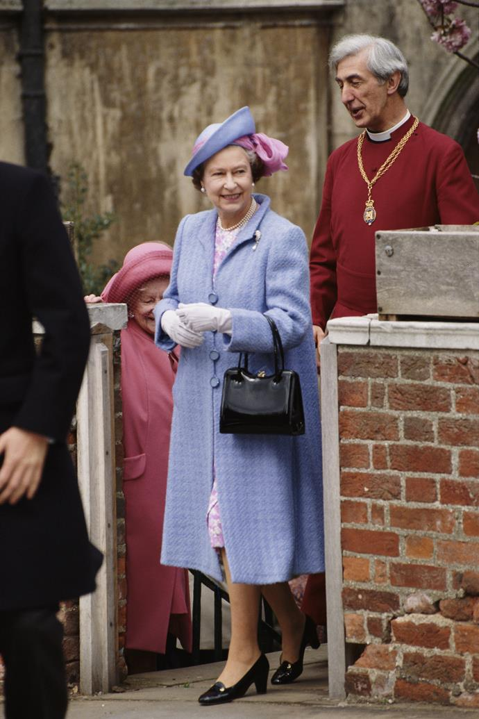 Pastels must have been big that year, the Queen opted for this beautiful lilac coat with pink accessory trimmings.