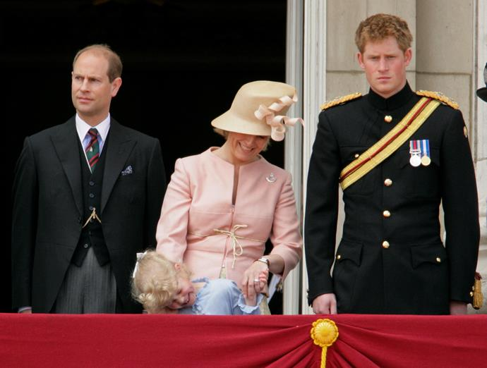 The Queen's youngest granddaughter had a giggle with her mum at her first Trooping the Colour.