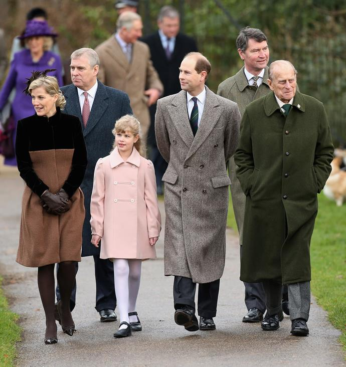 Walking with grandpa Philip to the annual Christmas church service at Sandringham.