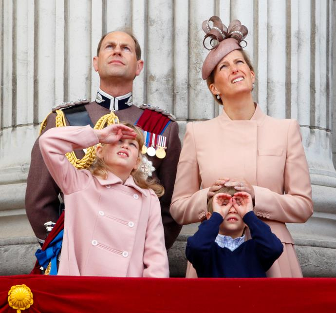 James dons his special spyglasses for his first Trooping the Colour.