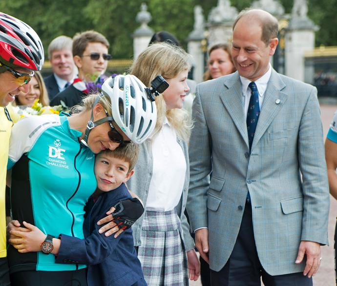 The family support Countess Sophie after one of her numerous charity bike rides.