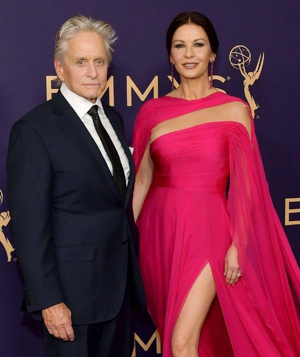 **CATHERINE ZETA-JONES, 51, & MICHAEL DOUGLAS, 76: 25 YEARS**  <br><br> It was the actor's *Basic Instinct* to fall into the brunette beauty's *Entrapment*!