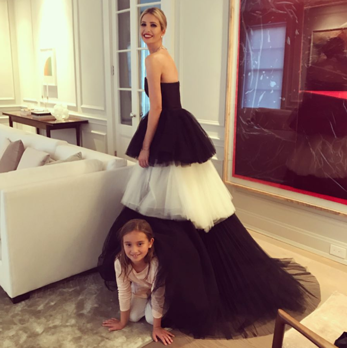 The dress Meghan wore for her groundbreaking *Vanity Fair* expose back in 2017 looked just like the one Ivanka's daughter Arabella hid under! See the highlights from her interview in the next slide.