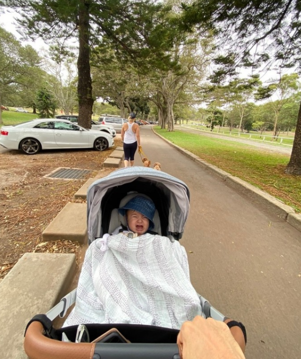 There's nothing more relaxing that going for a casual stroll... with a screaming baby in the pram. Right, Osher?