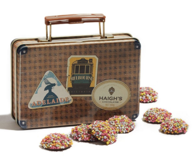 "**A NAUGHTY (BUT CLASSIC) CHOCOLATE SNACK** <br><br> There are regular freckles, and then there are Haigh's special ""Speckles"". These delicious little morsels are to die for - and this cute suitcase tin contains loads of them.  <br><br> **[AVAILABLE FROM: Haigh's online, $17.50](https://www.haighschocolates.com.au/milk-chocolate-speckles-1