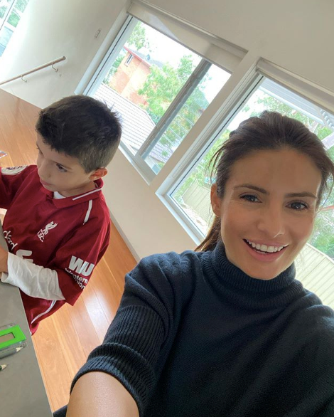 The 42-year-old mum also *knows* how to rock a turtle neck. So much so that she couldn't help herself capturing the moment, while her son Johnas worked diligently. Check out our favourite turtleneck dupe below.
