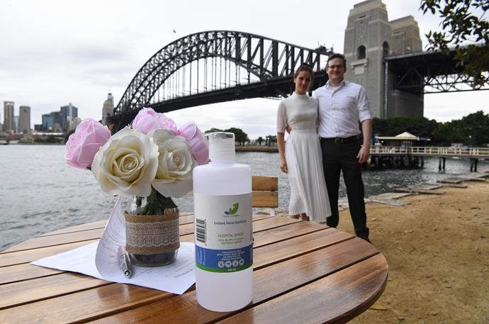 Sydney couple Lara Laas and Daniel Clark tied the knot with the most precious wedding gift - hand sanitiser. They're just missing the toilet roll!