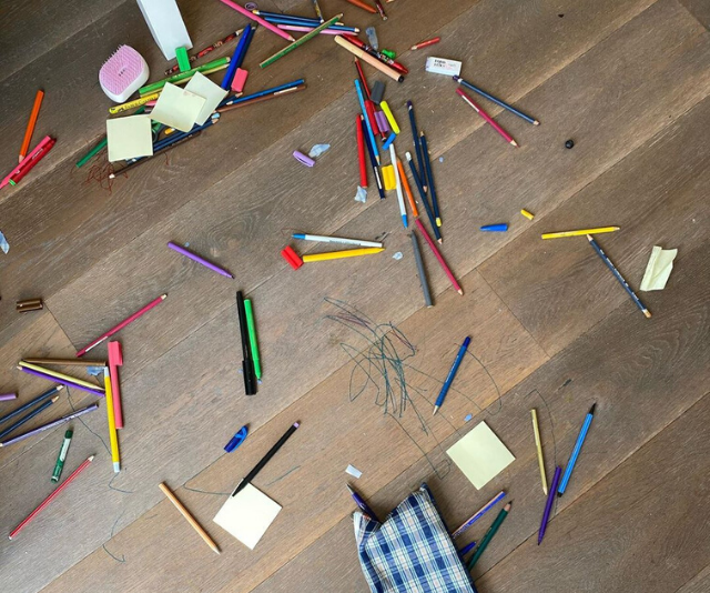 The familiar sight of pens and pencils strewn all over the floor.