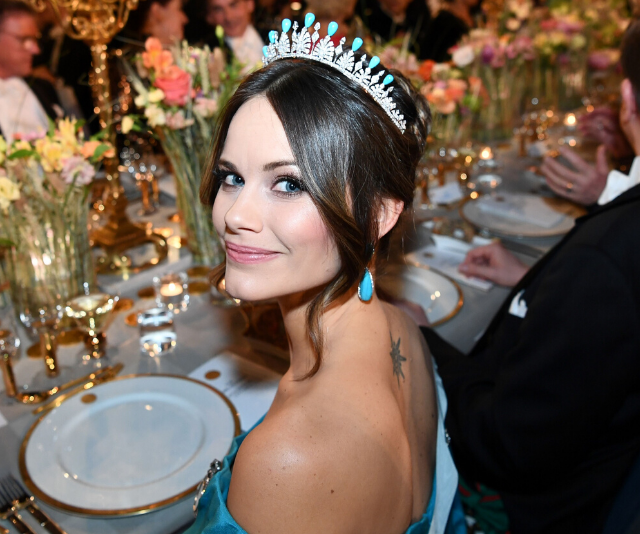 Princess Sofia is famous for her stunning looks and glamorous outfits. She is pictured here wearing a tiara and earrings that match her blue ballgown.