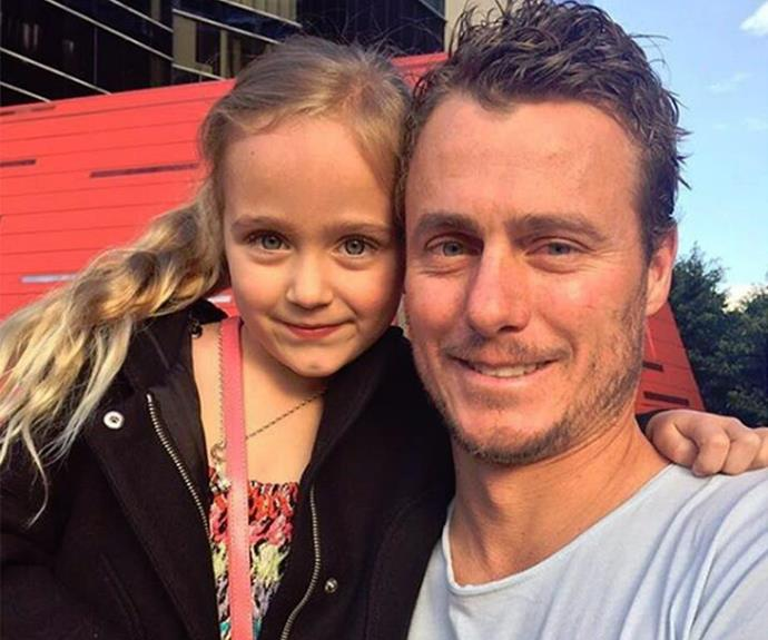 Lleyton cuddles up with his youngest, Ava.
