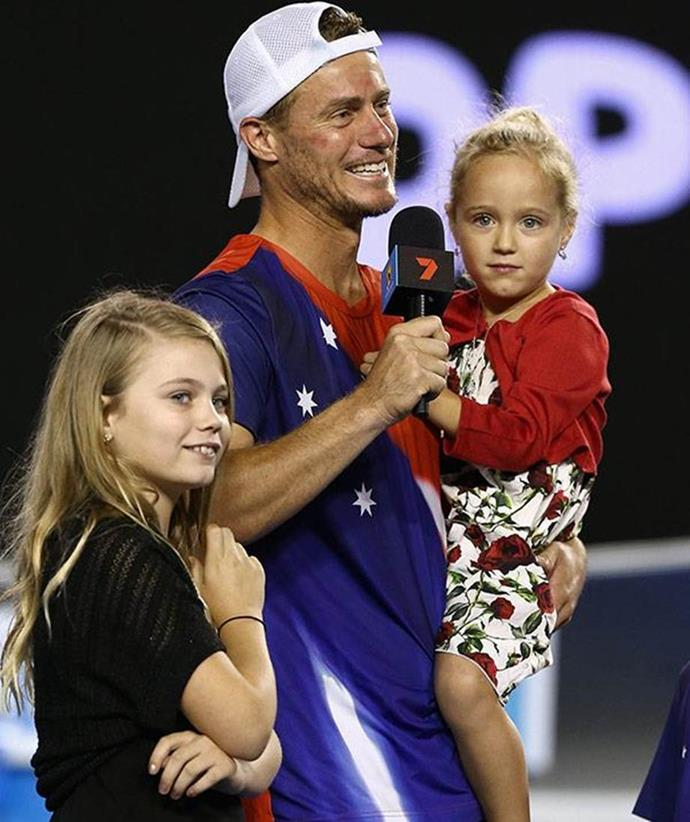 Mia and Ava join Lleyton on court during his retirement speech in 2016.