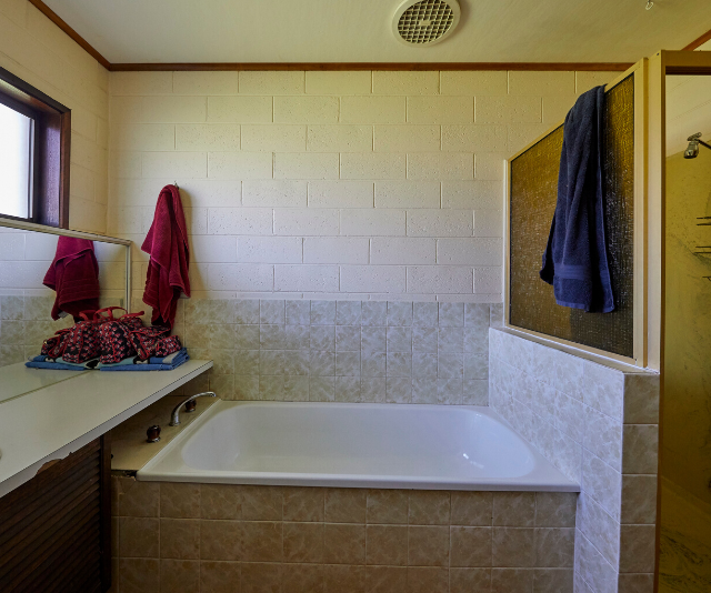 "The ""before"" bathroom could definitely do with a refresh."