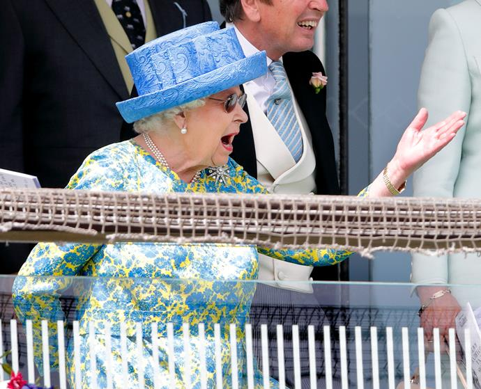 On-trend Elizabeth was animated at the Epsom Derby Fesitval in 2019. Amidst the floral print, the hat, and the expression, there's a lot to take in - but it's the sunnies that really take the cake.