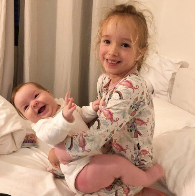 No Cabbage Patch Dolls necessary here! Trixie proves she's a natural with her baby sister.