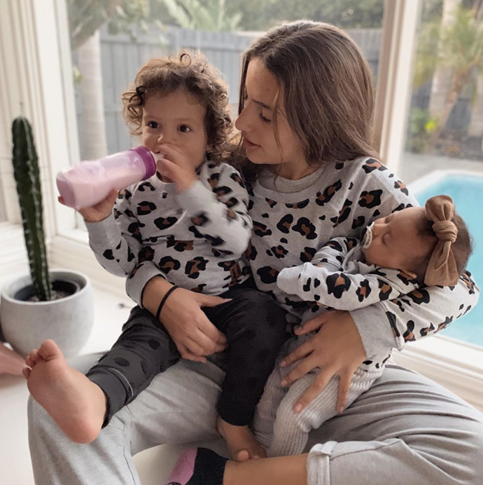 Our hearts are bursting at this shot of the three sisters in matching jumpers.